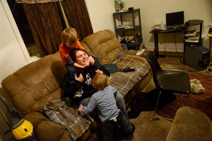 20131126MWHpovertyLocal01-3 Jessica Peace, 25, plays with her children Braydon Kulesza, 5, on top, and Noah Kulesza, 2, at a friend's home Tuesday in McDonald. Ms. Peace, a single mother, is currently homeless and is staying with a friend while she looks for affordable housing.