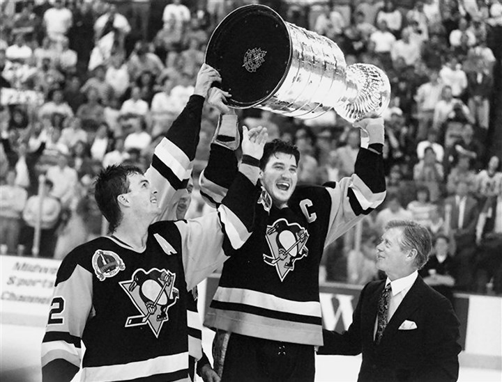 3030 pens Bryan Trottier and Mario Lemieux hold the Stanley Cup after beating the Chicago Blackhawks for the NHL title in 1992. Lemieux led the Penguins to two Stanley Cup championships.