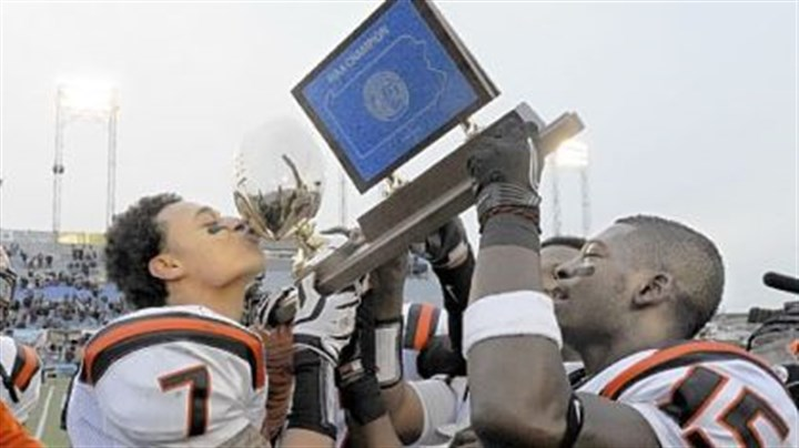 55 and counting Clairton's Dakota Halcomb kisses the PIAA Class A trophy in 2011. The Bears are riding a 55-game winning streak.