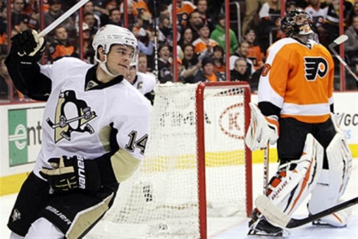 A goal The Penguins' Chris Kunitz reacts after scoring on Flyers' goalie Ilya Bryzgalov last night in the first period. Kunitz scored again in the third period.