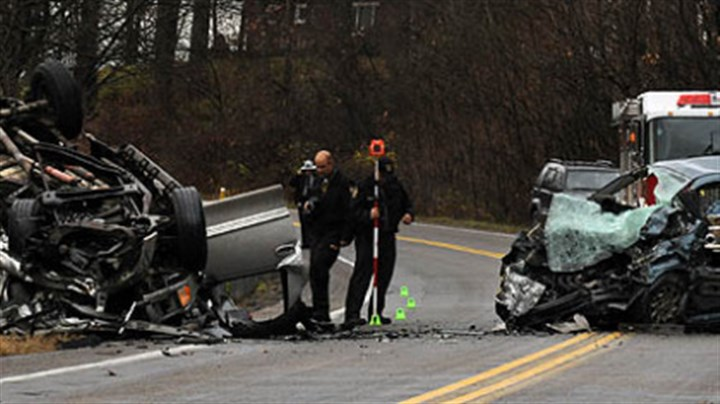 Accident scene State police investigate the scene of an accident in Butler County in which four people were killed.