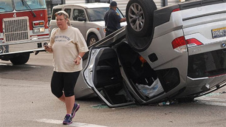 Accident scene Susan Leff, of Squirrel Hill, walks away from a car driven by her sister Ann Averback, following an accident at the intersection of Stanwix Street and Fort Pitt Boulevard.