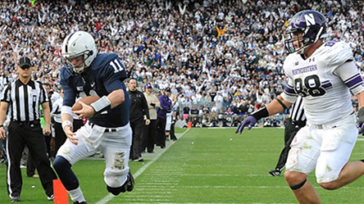 Across the line Penn State quarterback Matt McGloin leaps in to the end zone scoring the game-winning touchdown against Northwestern in today's game at State College.