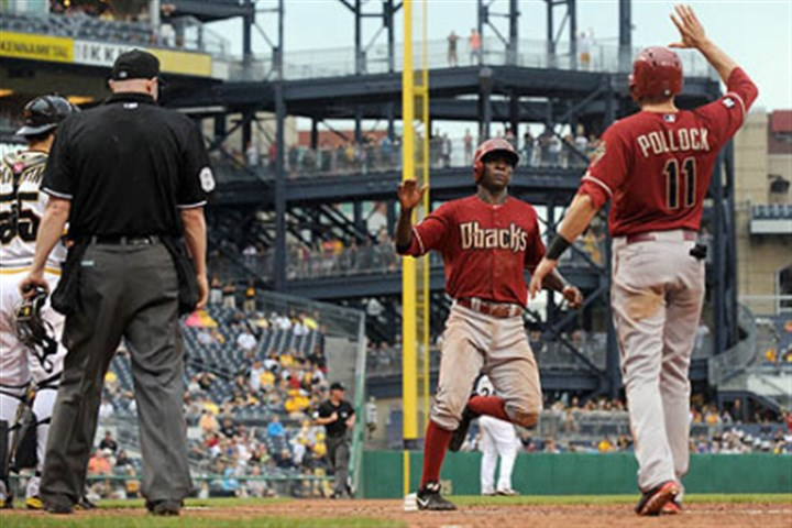 Adam Eaton Diamondbacks' Didi Gregorius is congratulated by A.J. Pollock after scoring on a hit by Adam Eaton to go ahead of the Pirates in the 16th inning at PNC Park Sunday.