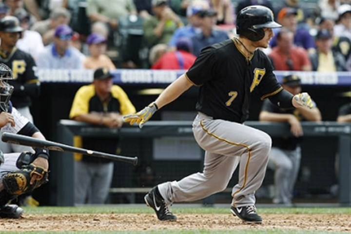 Alex Presley The Pirates' Alex Presley singles against the Colorado Rockies in the fifth inning Sunday.