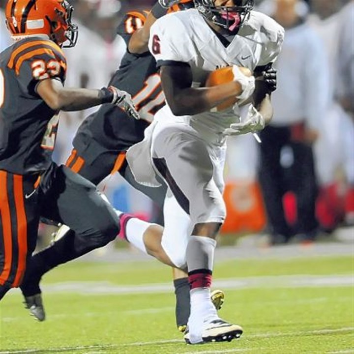 Aliquippa's Dravon Henry Aliquippa's Dravon Henry carries against Beaver Falls Friday.