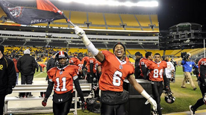 Aliquippa's Dravon Henry Aliquippa's Dravon Henry waves the school flag after defeating the Washington Prexies Nov. 23 in the WPIAL Class AA championship at Heinz Field. The Quips are looking for their first PIAA title since 2003.
