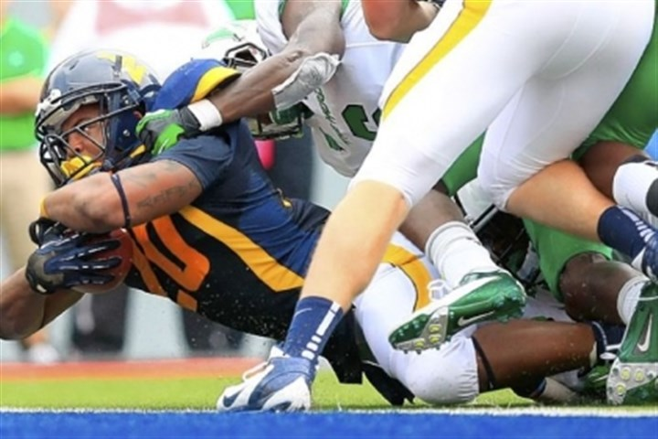 Alston West Virginia running back Shawne Alston dives in for a touchdown against Marshall Sept. 1 in Morgantown, W.Va. Alston might be drafted next week by the NFL, but if not, he isn't worried because he has a plan for his future.