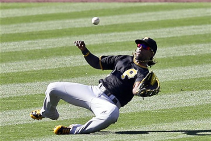 Andrew McCutchen Pirates center fielder Andrew McCutchen unsuccessfully tries for a sliding catch on a ball hit by the Padres' Logan Forsythe in the second inning.