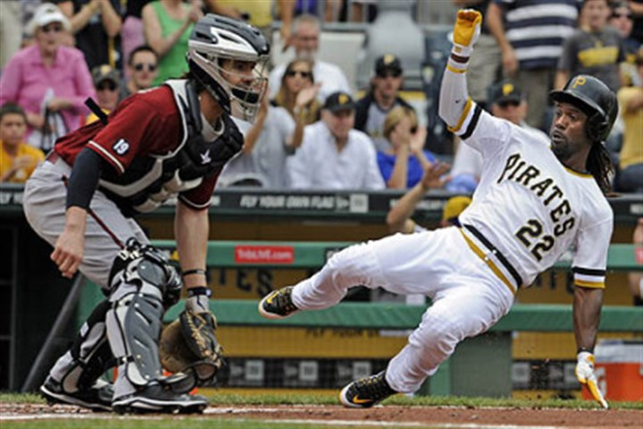 Andrew McCutchen The Pirates' Andrew McCutchen slides safely into home plate against the Diamondbacks' Tuffy Gosewisch in the first inning.