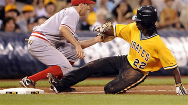 Andrew McCutchen Pirates' Andrew McCutchen slides safely into third with a triple against Reds Adam Rosales in the fifth inning tonight at PNC Park.