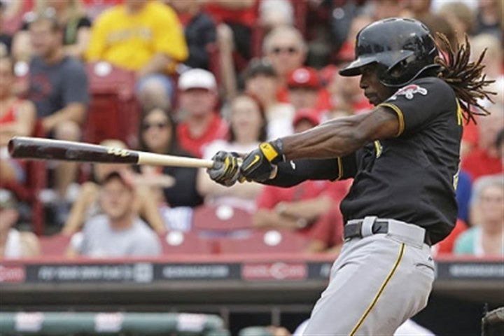 Andrew McCutchen The Pirates' Andrew McCutchen hits a solo home run off Cincinnati Reds starting pitcher Mat Latos in the fourth inning.