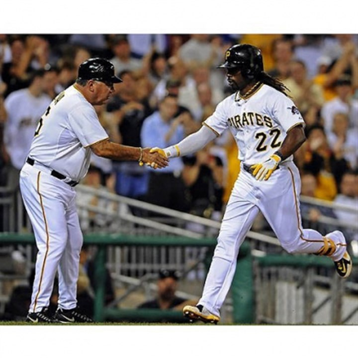 Andrew McCutchen and Nick Leyva The Pirates' Andrew McCutchen is congratulated by third base coach Nick Leyva after hitting a home run against the Marlins in the fourth inning Wednesday night at PNC Park.