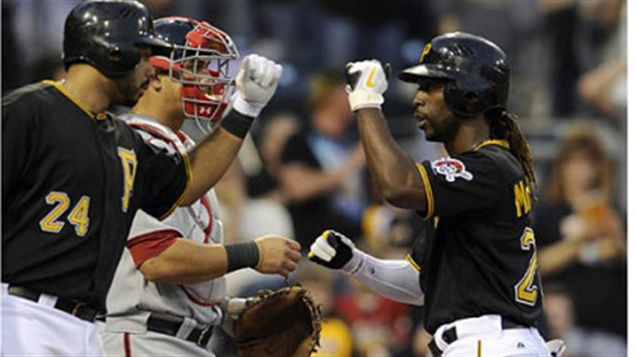 Andrew McCutchen and Pedro Alvarez Andrew McCutchen is congratulated by Pedro Alvarez after hitting his first home run of the season.
