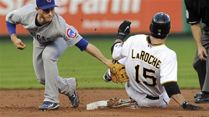Andy LaRoche and Mike Fontenot The Pirates' Andy LaRoche slides into second base safely as Cubs second baseman Mike Fontenot applies the tag in the third inning.