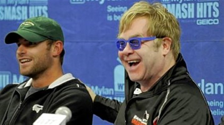 Andy Roddick and Elton John Elton John jokes with Andy Roddick before the start of the Mylan World Team Tennis Smash Hits Tuesday at Petersen Events Center.