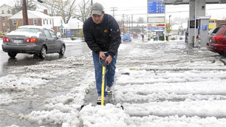 Angel Rodriguez Angel Rodriguez, 22, removes snow at a gas station parking lot on Tuesday in Morgantown, W.Va.