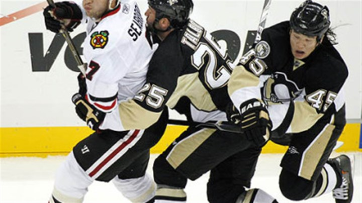 Arron Asham, Max Talbot and Brent Seabrook Penguins forward Arron Asham collides with teammate Max Talbot behind Blackhawks defenseman Brent Seabrook in the first period.