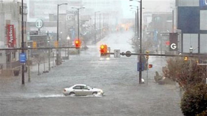 Atlantic City Flooding and high winds arrive Monday along North Michigan Avenue in Atlantic City, N.J.