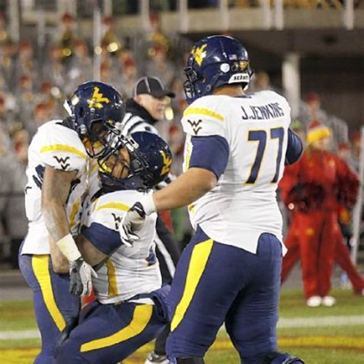 austin West Virginia wide receiver Tavon Austin, left, celebrates his touchdown with running back Shawne Alston, center, and offensive linesman Josh Jenkins, in the second half Friday against Iowa State in Ames, Iowa.