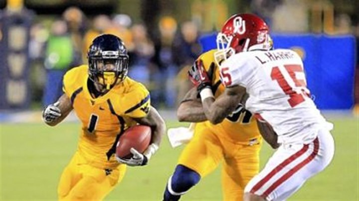 austin Tavon Austin set a I-A division record Saturday with 572 all-purpose yards, including a West Virginia record 344 rushing yards.