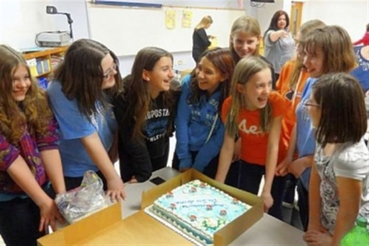 Bears Members of the sixth-grade team from South Allegheny School District who won the Project Polar Bear Contest celebrate with an Arctic-themed cake after learning they captured first place in the contest.