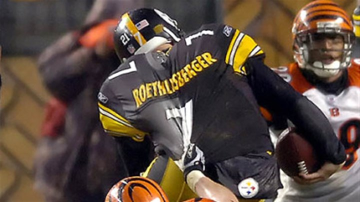 Ben Roethlisberger Bengals' defensive end Justin Smith tries to drag quarterback Ben Roethlisberger down by his jersey. (vs. Bengals 12/02/2007)