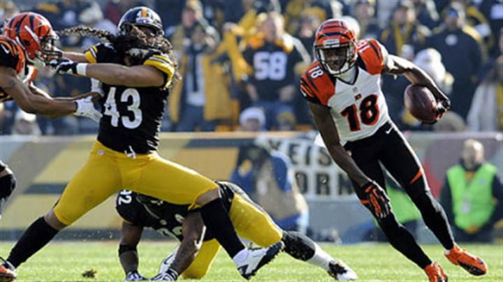 Bengals' A.J. Green carries around Steelers' Troy Polamalu Bengals' A.J. Green carries around Steelers' Troy Polamalu in the first quarter at Heinz Field Sunday.