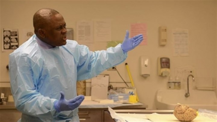 Bennet Omalu Bennet Omalu, shown with a preserved brain at North Shore University HealthSystem's hospital in Evanston, Ill., was the first pathologist to detect CTE in a former pro football player, Steelers great Mike Webster.