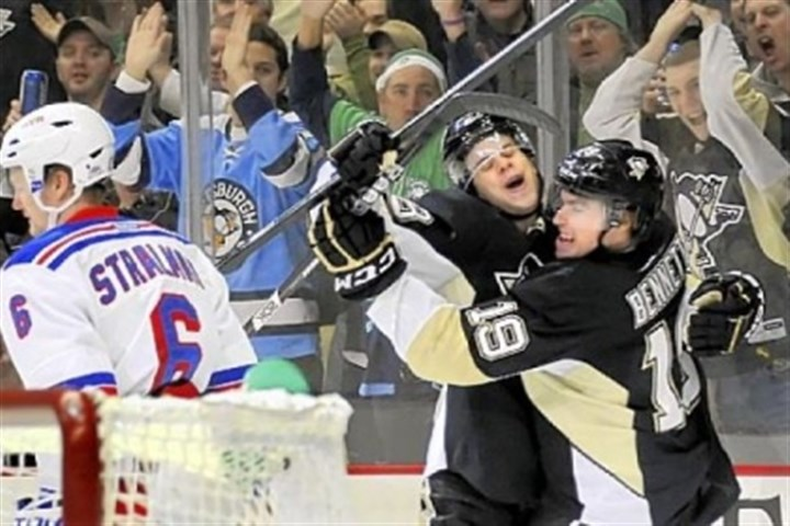 Bennett Beau Bennett, right, is congratulated by Tyler Kennedy after giving the Penguins a 1-0 lead.