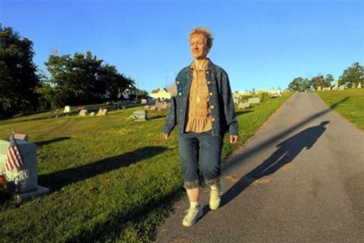 Beth Walley Beth Walley, 50, takes her after dinner walks through St. Joseph Cemetery in her Carnegie neighborhood.