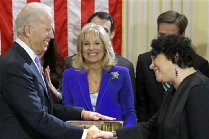 Bidens Vice President Joe Biden, with his wife, Jill Biden, center, holding the Biden family Bible, shakes hands Sunday with Supreme Court Justice Sonia Sotomayor after taking the oath of office during a ceremony at the Naval Observatory in Washington.