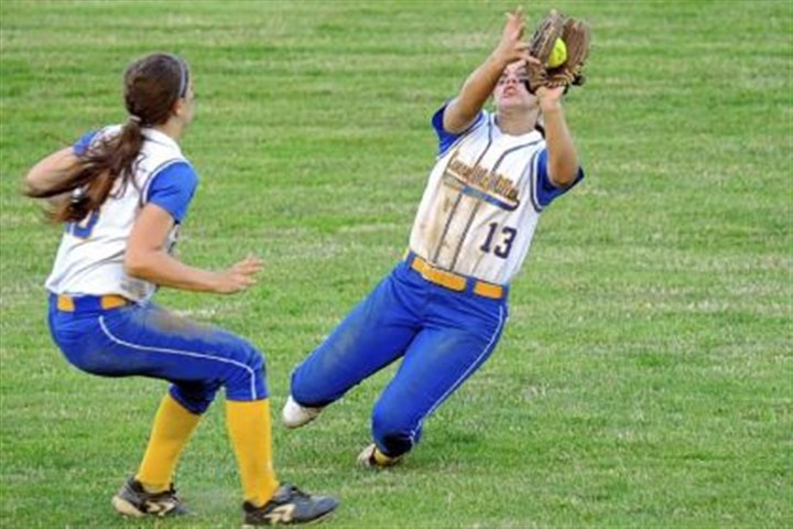 Big Macs Softball Canon-McMillan's Abby McCartney pulls in a fly ball next to Alison Bellaire against North Allegheny in the WPIAL Class AAAA championship game on May 30.