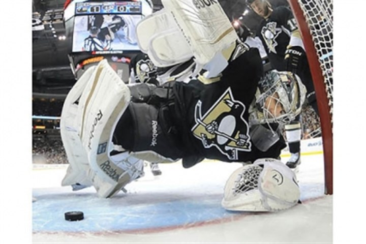 big save Penguins goalie Marc-Andre Fleury makes big save against the Rangers in the third period.