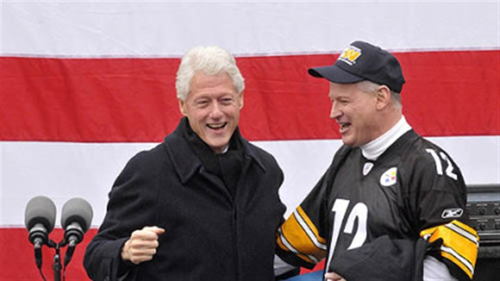 Bill Clinton and Critz Former U..S. President Bill Clinton reacts after embracing U.S. Rep. Mark Critz, who is running for re-election against Republican challenger Keith Rothfus.