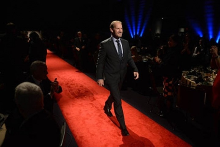 Bill Cowher Former Pittsburgh Steelers coach Bill Cowher walks the rent carpet.