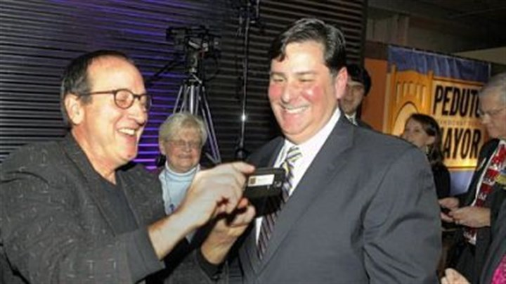 Bill Peduto Former city council president Doug Shields, left, shows Councilman Bill Peduto the photo he just took as Mr. Peduto announced his run for mayor of Pittsburgh Thursday at the Crucible Building in the Strip District.