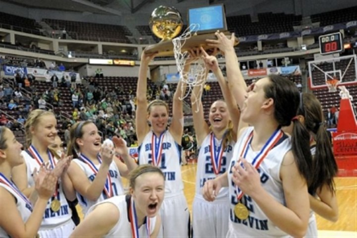Bishop Canevin-1 Bishop Canevin players celebrate after defeating York Catholic 45-38 in the PIAA AA Girls basketball championship Friday at Giant Center in Hershey, Pa.