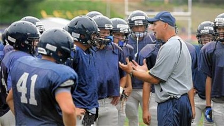 Blue Devils Mt. Lebanon's new head coach, Mike Melnyk, speaks to his players during a preseason practice session last Friday.