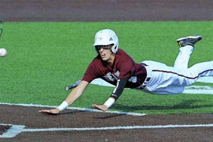 Bobcats Baseball Beaver's Matthew Rose dives safely into home as Quaker Valley catcher Ben Utterback takes the throw in the WPIAL Class AA championship at Consol Energy Field.