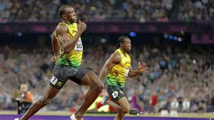 bolt Jamaica's Usain Bolt, left, passes compatriot Yohan Blake as he races to his gold medal finish in the men's 200-meter final.