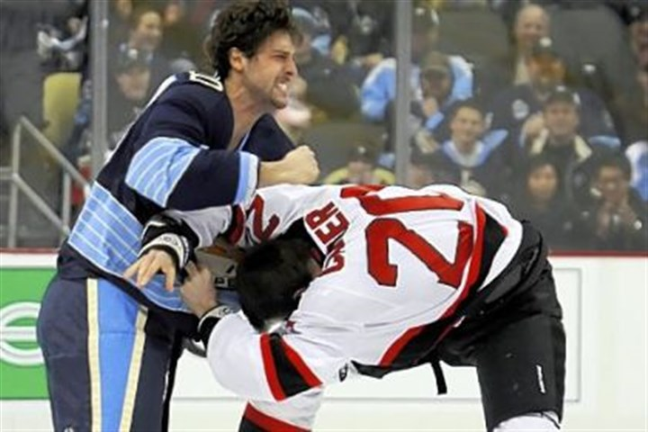 BortuzzoFight The Penguins' Robert Bortuzzo, left, fights the Devils' Ryan Carter on the opening faceoff of a game in February.