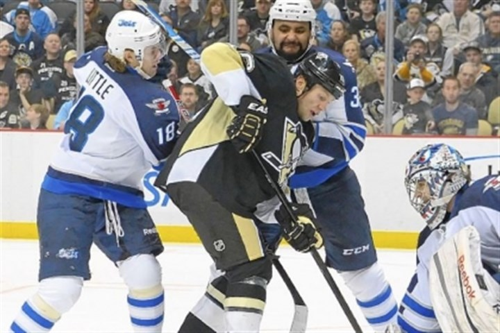 Brenden Morrow The Penguins' Brenden Morrow is double-teamed in front of Jets goalie Al Montoya in the third period.