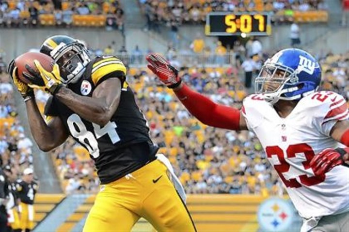 brown Antonio Brown can't stay in bounds as he hauls in pass to the corner against the Giants' Corey Webster in the first quarter.