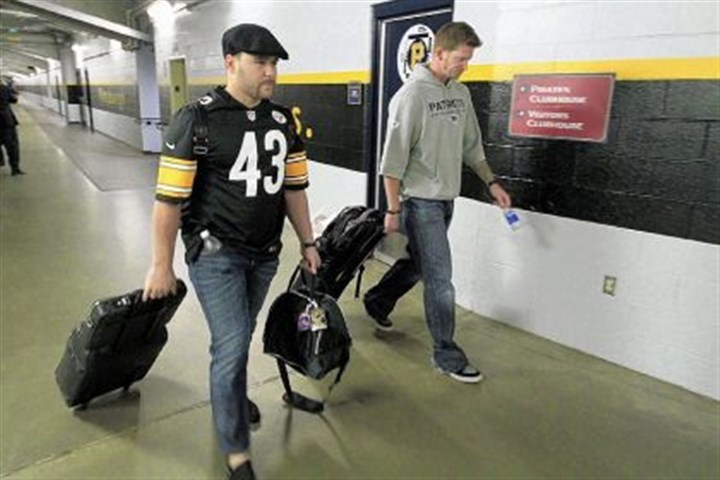 burnett Catcher Russell Martin, left, and pitcher A.J. Burnett wore their other teams on their sleeves Sunday -- Martin in a Steelers Troy Polamalu jersey and Burnett in a Patriots sweatshirt -- after the Pirates game.