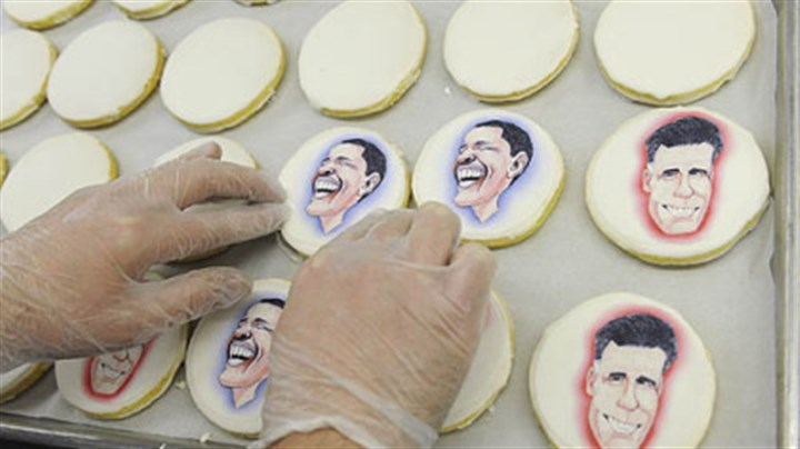 caricatures of cookies hands Edible paper with caricatures of the presidential candidates to shortbread cookies at Bethel Bakery in Bethel Park on Wednesday.
