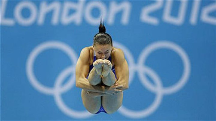 Cassidy Krug Kennedy native Cassidy Krug competes during the women's 3-meter springboard diving semifinal today.