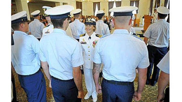 Change of command Incoming commander Lindsay N. Weaver, center, greets members of her unit during a traditional inspection of personnel during the Coast Guard change of command ceremony at the University Club in Oakland on Friday. Cmdr. Weaver will be the first female commanding officer and the first Latina top officer at Pittsburgh's Marine Safety Unit.