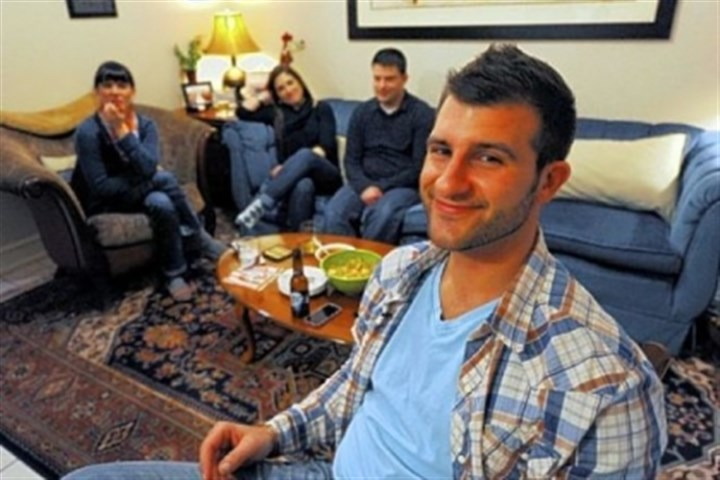 "Chase Rogan Lawrenceville's Chase Rogan with his wife, Taylor, left, and Megan and Paul Tarasi in Mr. Rogan's living room waiting for the ninth episode of Spike TV's ""The Joe Schmo Show"" to begin."