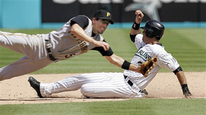 Chris Gomez Marlins' Jorge Cantu slides safely past Pirates second baseman Chris Gomez with a stolen base yesterday in the eighth inning. The Pirates won, 9-2.